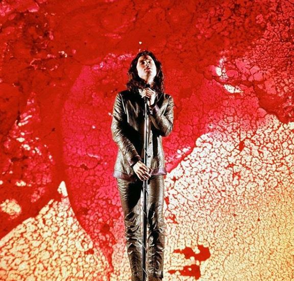Jim Morrison performing on stage