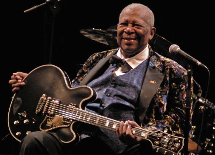 BB King holding his guitar