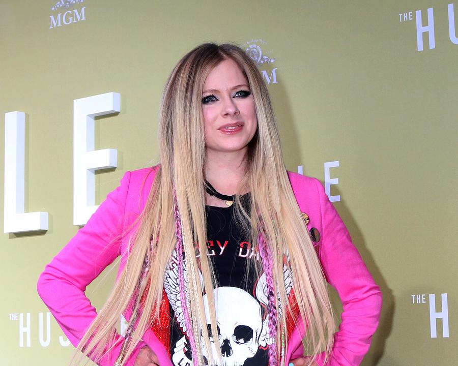 "Avril Lavigne smiling at ""The Hustle"" Premiere"